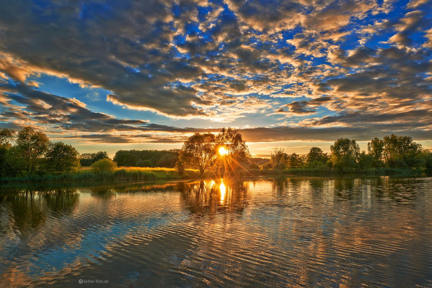 Die Sonne malt ihr Landschaftsbild